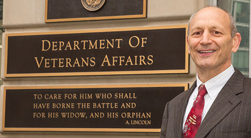 Tom Edes in front of Veterans Affairs sign