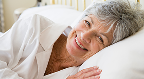 older woman lying on pillow