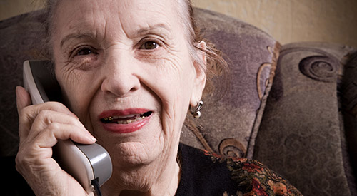 elderly woman holding a  phone