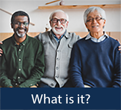 Three elderly men smiling