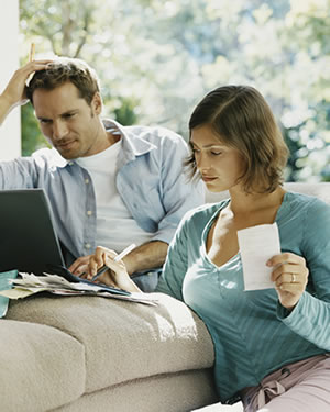 A couple examining their finances.