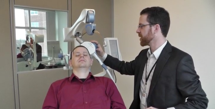 A Veteran being treated with TMS by Dr. Noah Philip.