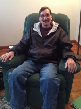Veteran sitting in his chair in his new home