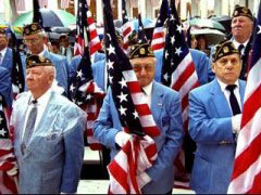 Veterans holding American flags