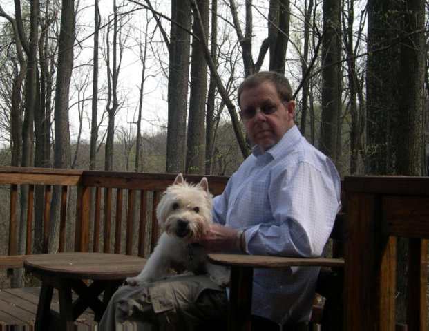 Alan Campbell sittin on deck with dog