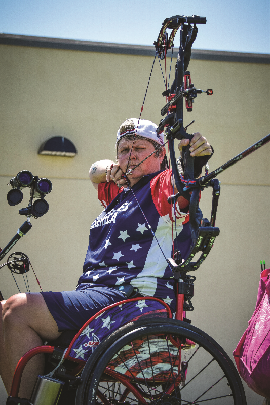 Lia Coryell holidng arrow at Wheelchair Games