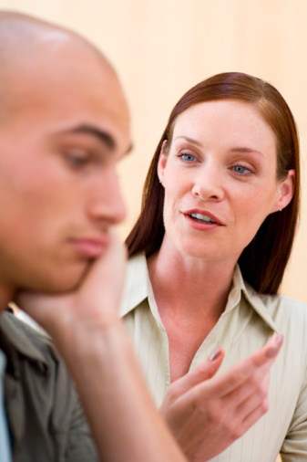 Man Thinking as woman discusses something with him