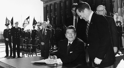 President Ronald Reagan signing bill to make VA a cabinet-level department