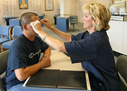 patient getting eyeglasses adjusted