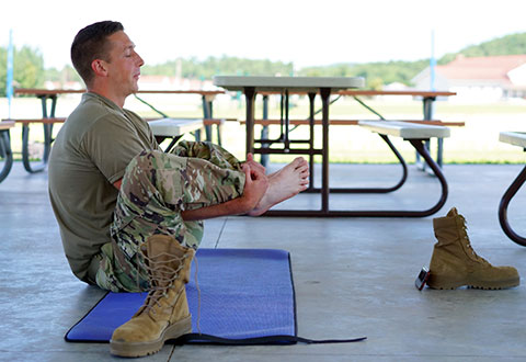 servicemember in yoga pose