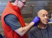 USAF Veteran Ronnie Leeth receives battlefield acupuncture (BFA) from VA Dr. Dan Federman.