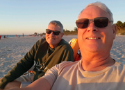 Vet and Husband on beach.