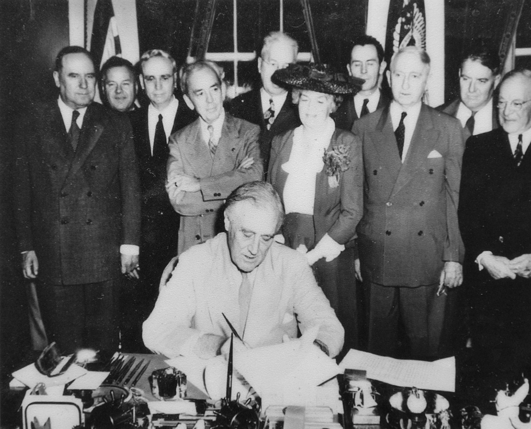 FDR signing GI Bill into law
