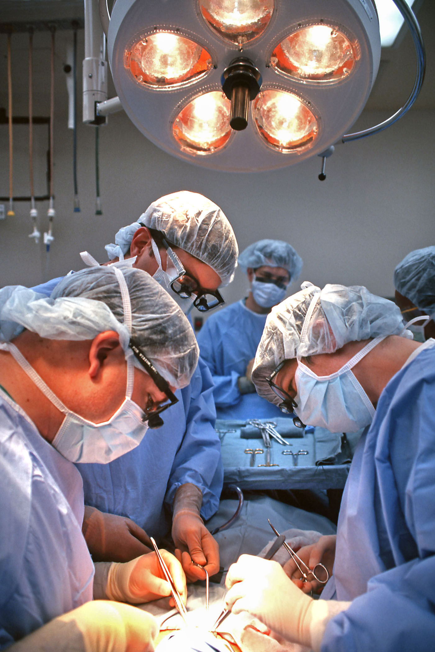 Doctors conducting surgery on a patient