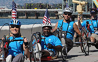 Photograph of veterans riding tricycles