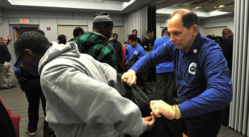 Secretary VA Helping Veteran put on a coat