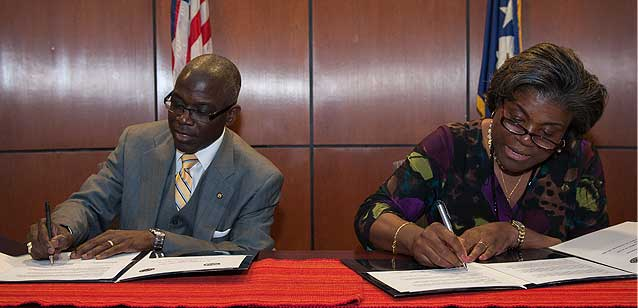 VA and the State Department siging a MOU