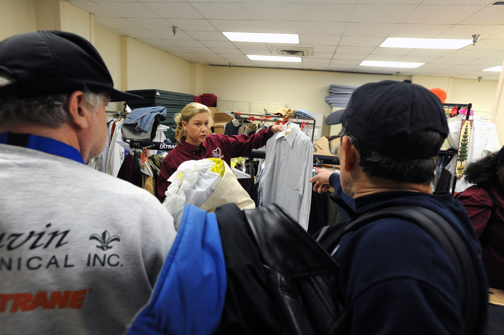 A volunteer prepares to distribute clothes to homeless Veterans during a Washington D.C. VA Medical Center Winterhaven Veteran stand down.
