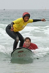 Clinic participant on a surfboard.