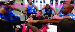 Coach Paul Welty in a huddle with his team at the 2011 National Veterans Wheelchair Games.