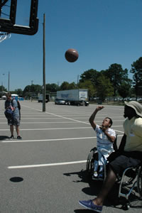 Ronnie Nickerson and Anthony Pone playing basketball