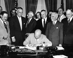 President Eisenhower signing HR7786 changing Armistice Day to Veterans Day