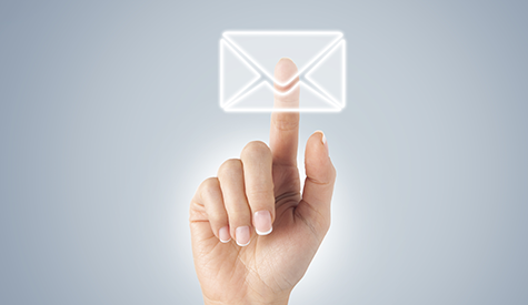 Hand/finger touching an email envelope