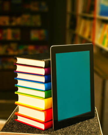 Stack of books with a tablet computer
