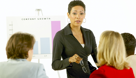 Business women presenting in meeting