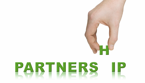 Hand building the word partnership