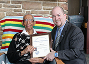 Charles P. Clark, the oldest living confirmed WWII Veteran receiving health care through the Department of Veterans Affairs pose with Timothy Cooke, the Martinsburg VAMC director during a Certificate of Appreciation presentation on March 16, 2015 at the medical center.